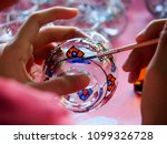the girl is using a paintbrush... | Shutterstock . vector #1099326728