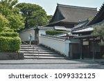 female tourist standing at... | Shutterstock . vector #1099332125