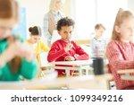 thoughtful schoolboy keeping... | Shutterstock . vector #1099349216