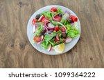 healthy vegetable salad is  on... | Shutterstock . vector #1099364222