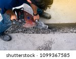 Male Worker Repairing Driveway...