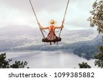 carefree woman on the swing on... | Shutterstock . vector #1099385882