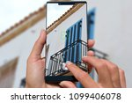woman with mobile phone photos... | Shutterstock . vector #1099406078