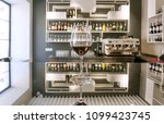wine glass on bar counter with... | Shutterstock . vector #1099423745