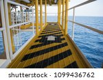 walkway on wellhead platform. | Shutterstock . vector #1099436762