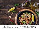 prawns shrimps roasted in... | Shutterstock . vector #1099443365