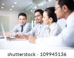 asian business team in meeting | Shutterstock . vector #109945136