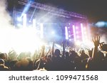 young people dancing and having ... | Shutterstock . vector #1099471568