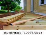 a new wooden  timber deck being ... | Shutterstock . vector #1099473815