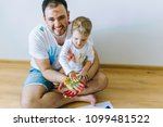 father and kid playing with... | Shutterstock . vector #1099481522
