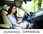 turning on radio at car driving ... | Shutterstock . vector #1099485026