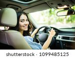 woman driver looking over the... | Shutterstock . vector #1099485125