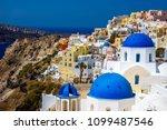oia town on santorini island ... | Shutterstock . vector #1099487546