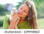 Stock photo happy girl with the rabbit outdoors 109948862