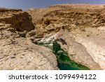 a stream of water in the rocky... | Shutterstock . vector #1099494122