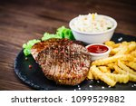 grilled steak with french fries ... | Shutterstock . vector #1099529882