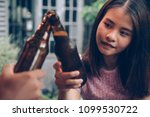 young woman drinking beer.... | Shutterstock . vector #1099530722