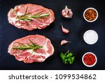 raw pork on black stone  | Shutterstock . vector #1099534862