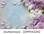 purple roses and lilacs on a... | Shutterstock . vector #1099542242