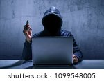 hacker using laptop. hacking... | Shutterstock . vector #1099548005