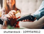 young woman paying with credit... | Shutterstock . vector #1099569812
