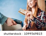 young woman paying with credit... | Shutterstock . vector #1099569815