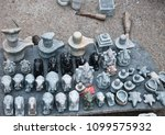 Small photo of Karnataka, Mysore, India, 1st May, 2018: Stone idols sold at Chamundi Hills road