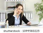 happy office worker calling on... | Shutterstock . vector #1099583225