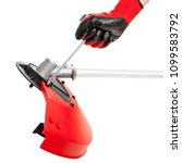 Small photo of Photos hands working with screwdriver mounting protective cover on the new weed trimmer isolated on white background with clipping path