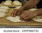 Small photo of Traditional Turkish Ramadan bread (pide)preparing in the bakehouse.Close up taken,isolated.