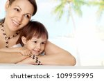 Charming Woman With Daughter At ...