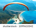 paragliding in the sky.... | Shutterstock . vector #1099610342