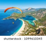paragliding in the sky.... | Shutterstock . vector #1099610345