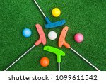 four colorful golf putters with ... | Shutterstock . vector #1099611542