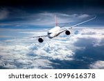 passenger plane in flight.... | Shutterstock . vector #1099616378
