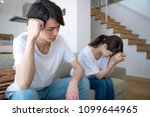 depressed young couple in the... | Shutterstock . vector #1099644965