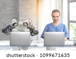 Small photo of The concept of using artificial intelligence to work in modern office in the future accurately. Beautiful young women using laptops work with modern office robots.