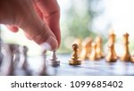 Small photo of Hand playing Chess game, Chess game competition business concept , Business competition concept Fighting and confronting problems.
