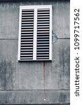 a closed white shutters window... | Shutterstock . vector #1099717562