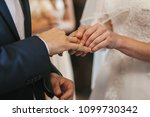 beautiful bride and groom hands ... | Shutterstock . vector #1099730342