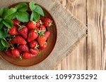 tasty strawberry on a wooden... | Shutterstock . vector #1099735292