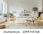 wooden table next to a yellow... | Shutterstock . vector #1099745768