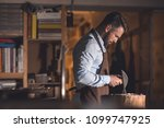 mature master at work in... | Shutterstock . vector #1099747925