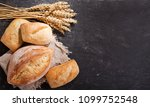 fresh bread with wheat ears on... | Shutterstock . vector #1099752548