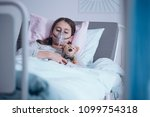 sick girl with oxygen mask...   Shutterstock . vector #1099754318