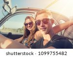 young couple in a retro car  at ... | Shutterstock . vector #1099755482