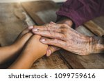 hands of the old man and a... | Shutterstock . vector #1099759616