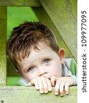 Sad Little Boy Inside A Wooden...