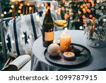 wine bottle  glass and candles... | Shutterstock . vector #1099787915