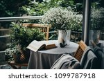 small table  book and flowers... | Shutterstock . vector #1099787918